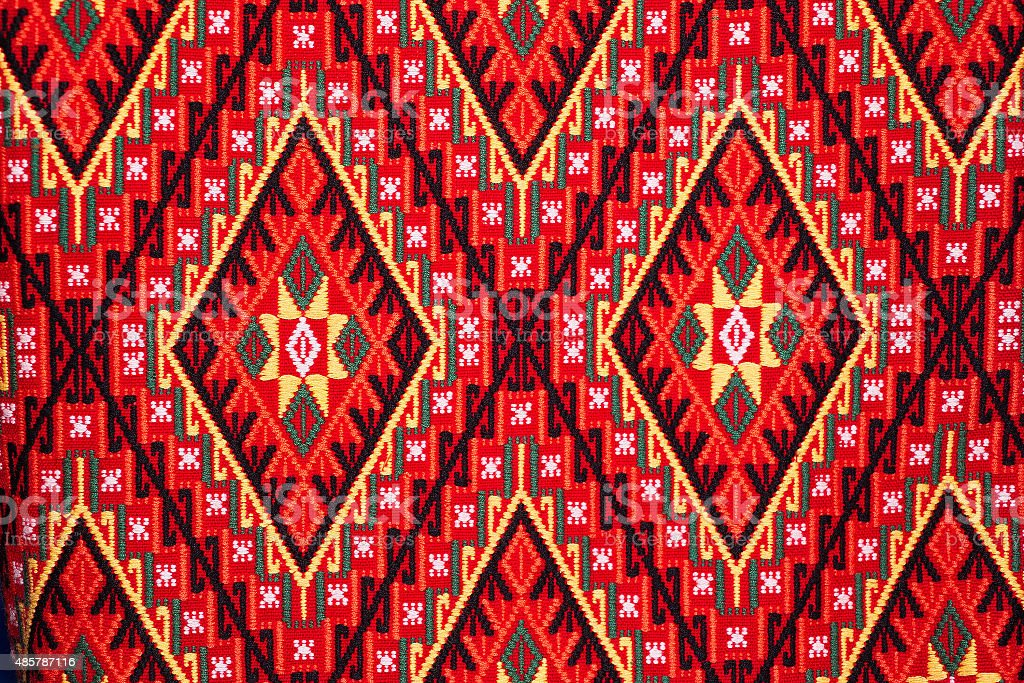 Colorful thai handcraft peruvian style rug surface close up. stock photo