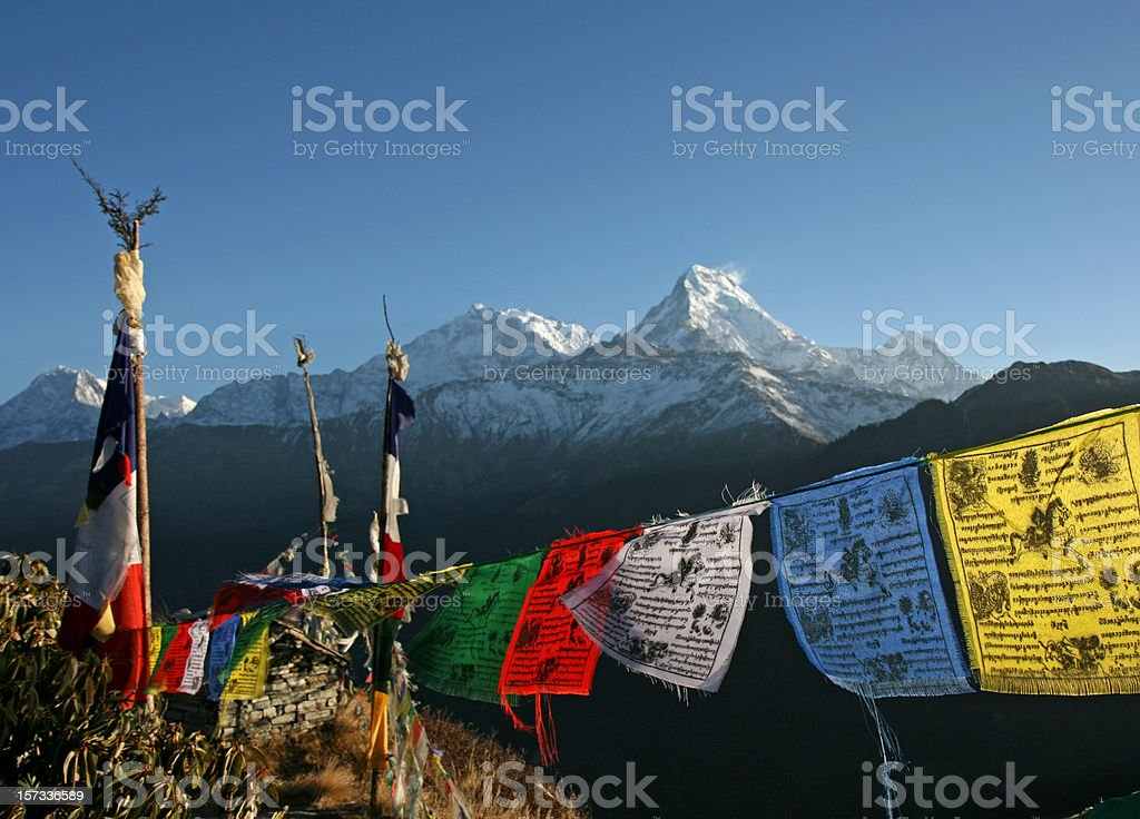 Colorful Tibetan prayer flags and the Annapurna mountains stock photo