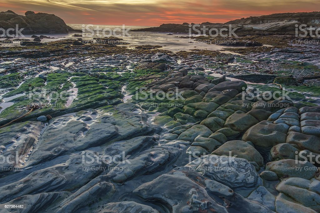 Colorful Tide Pools and Rock Formations stock photo