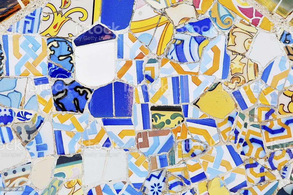 Colorful tiles patchwork close up in Gaudi Park Barcelona Spain stock photo