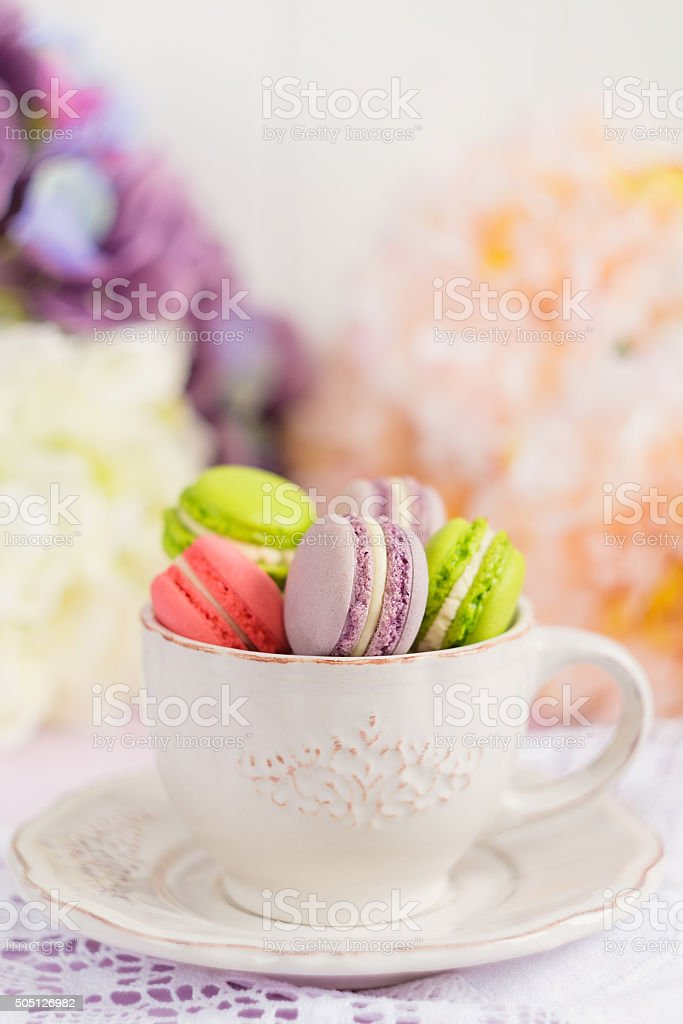Colorful tiny macaroons in the cup stock photo