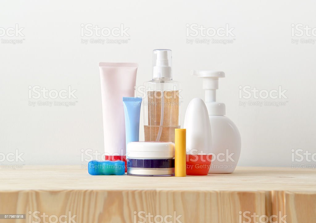 Colorful toiletries on the wooden cupboard stock photo