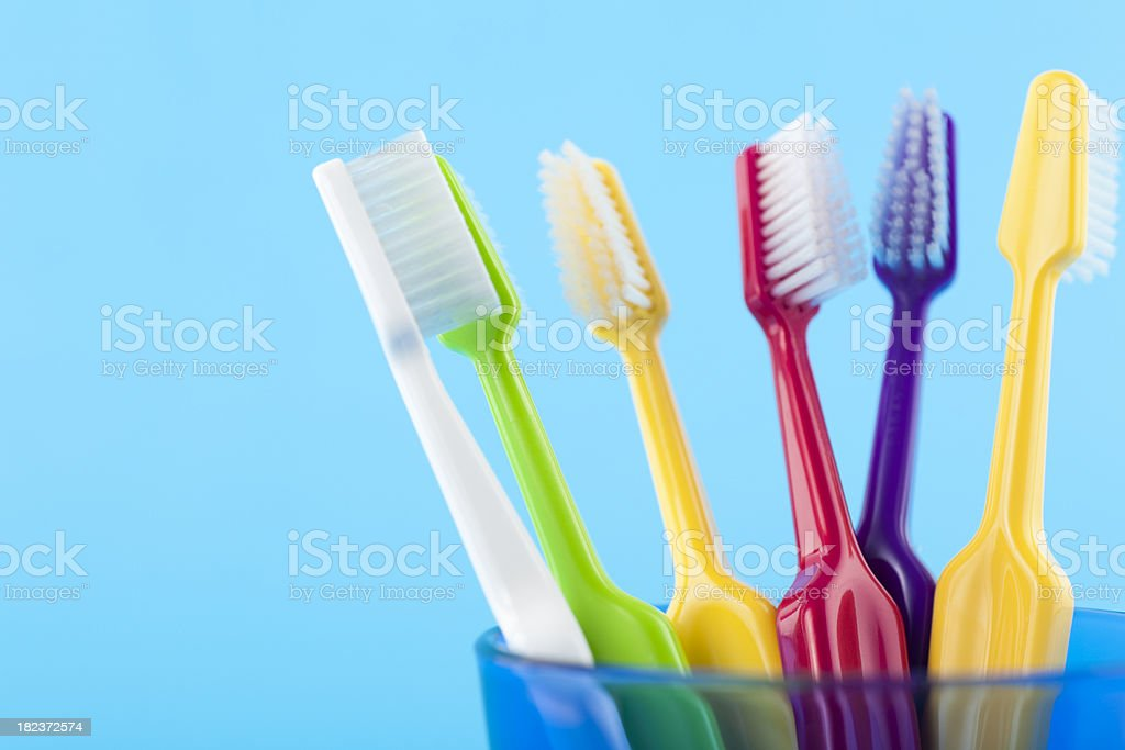 Colorful Toothbrushes in Glass stock photo
