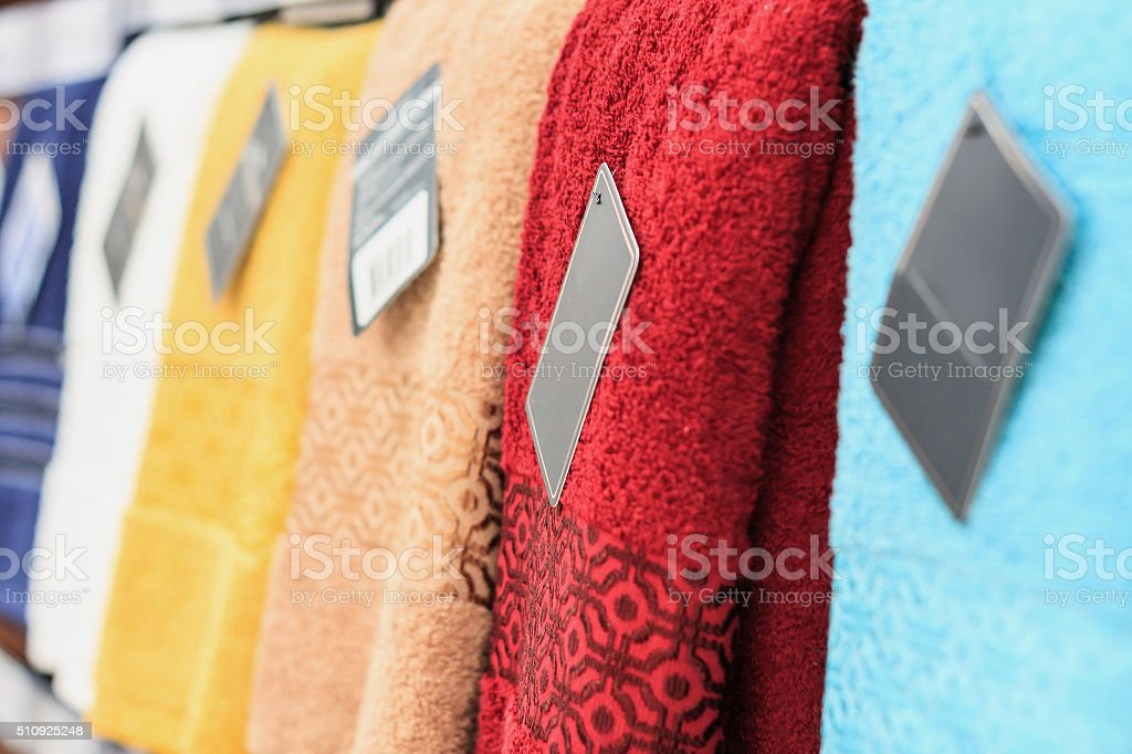 Colorful towels on supermarket shelves background stock photo