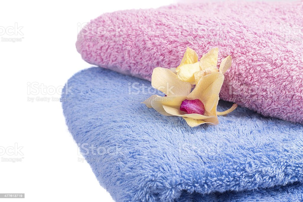 colorful towels with orchid flowers royalty-free stock photo