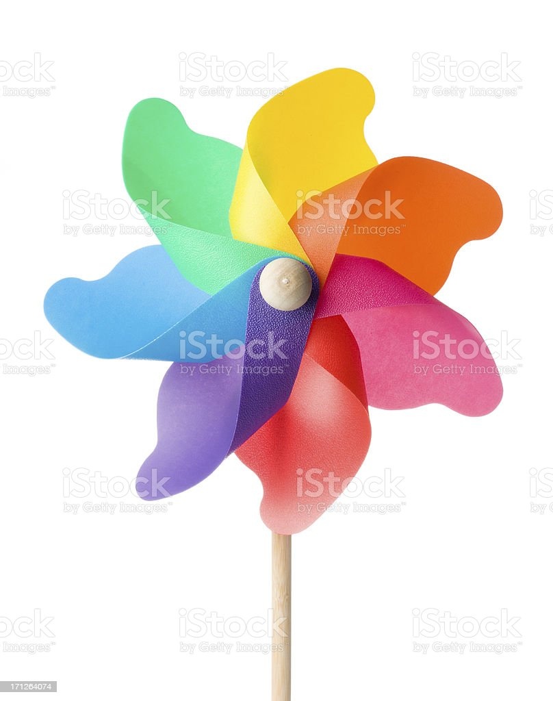 Colorful toy windmill on a white background stock photo