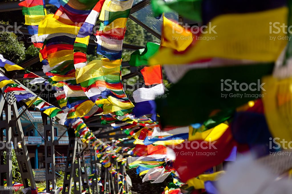 Colorful traditional Buddhist prayer flags fluttering in the breeze stock photo