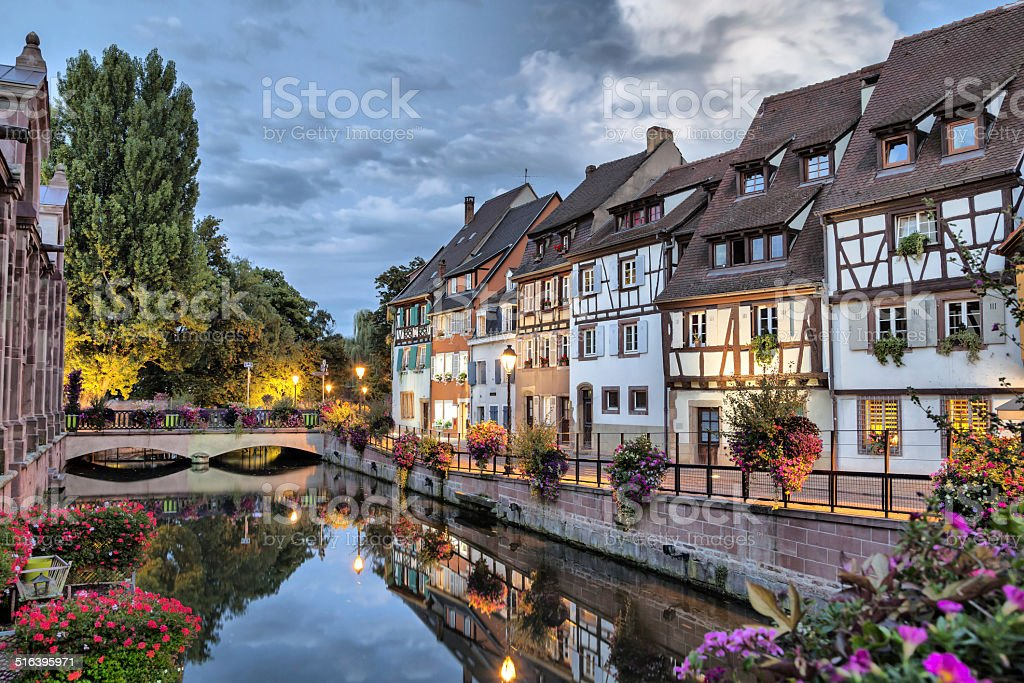 Colorful traditional french houses on the side of river stock photo