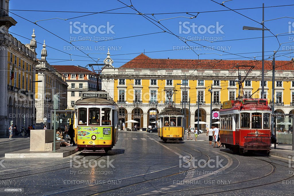 Colorful trams at the Commerce Square in Lisbon stock photo