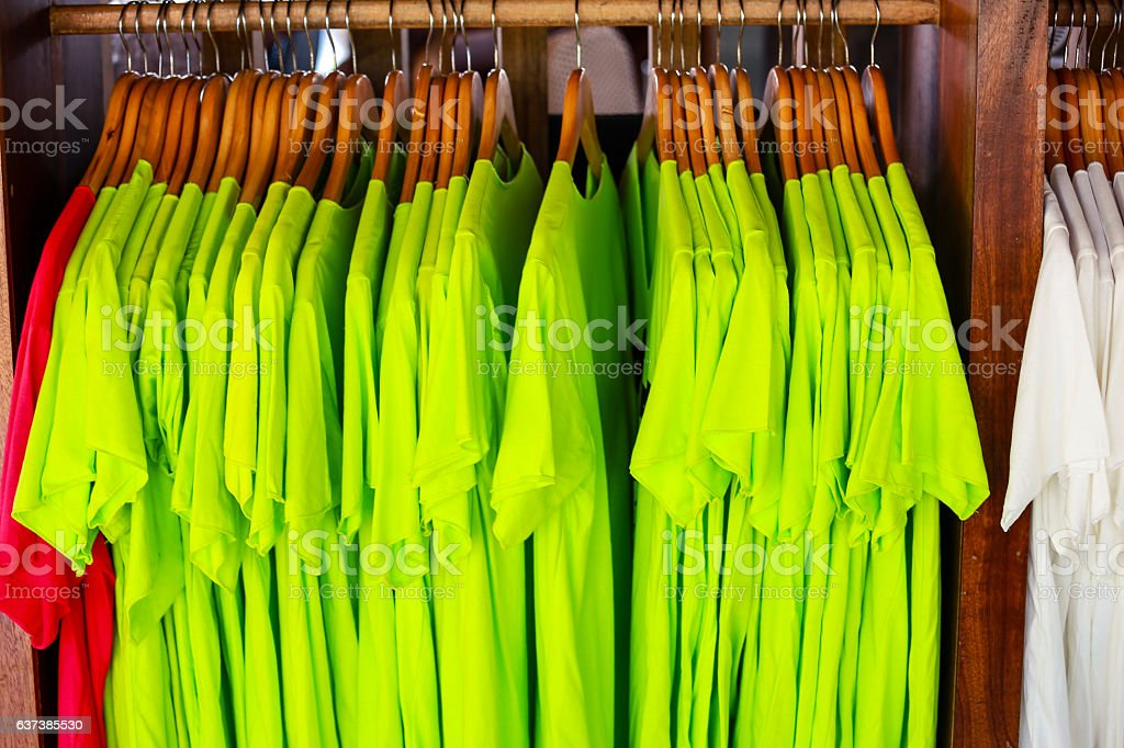 colorful t-shirt with hangers stock photo
