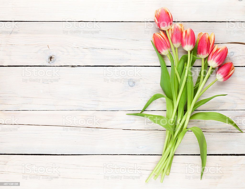 Colorful tulips on a wooden table stock photo