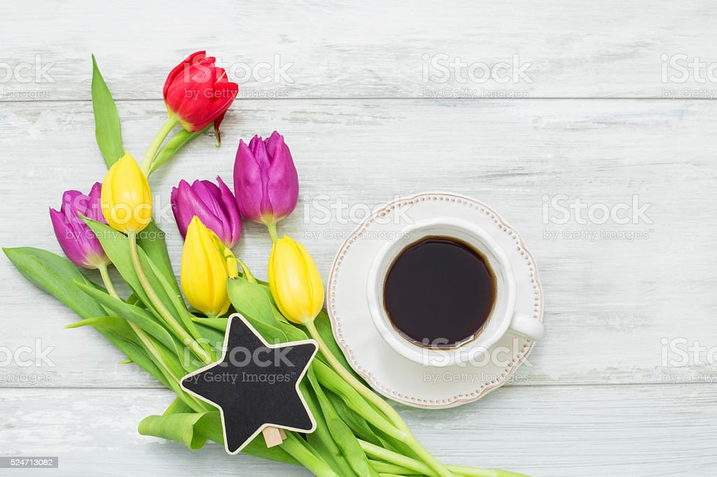 Colorful tulips with star shaped clip and coffee stock photo