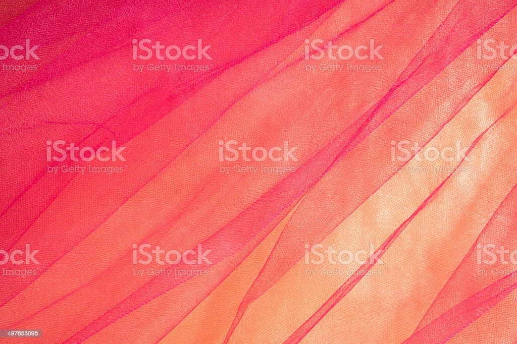 Colorful Tulle on Satin Fabric Background stock photo