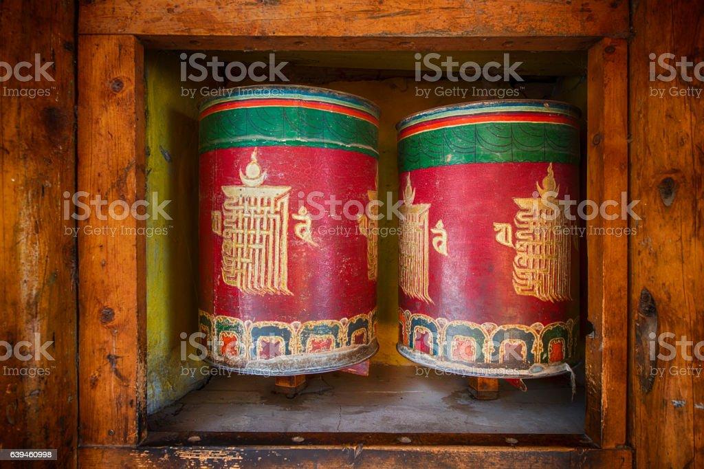 Colorful uddhist prayer wheels in Tibet stock photo