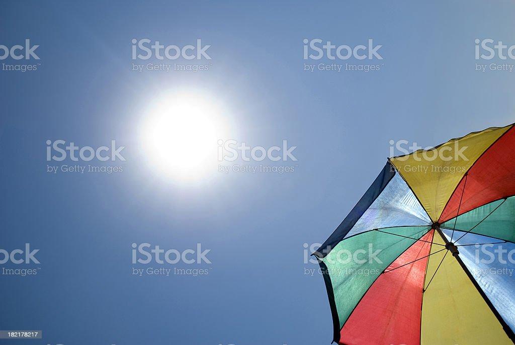 Colorful umbrella and sun stock photo