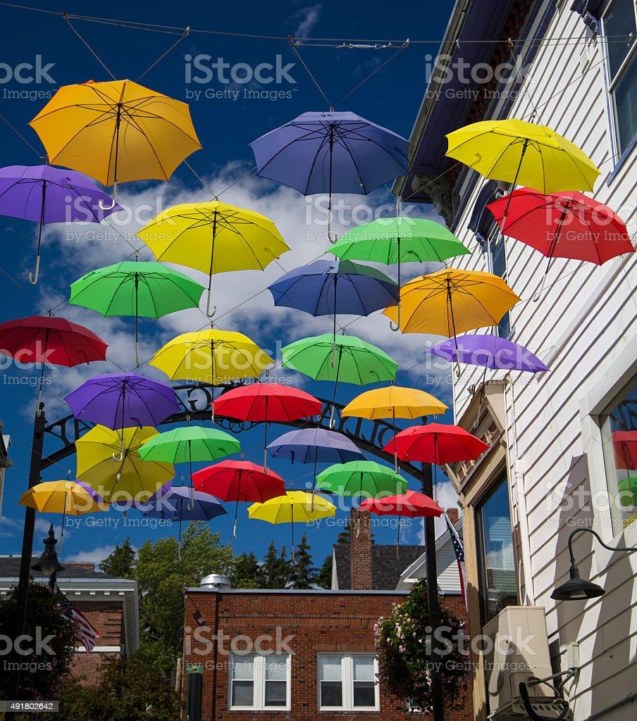 Colorful Umbrellas on Main Street--vertical stock photo