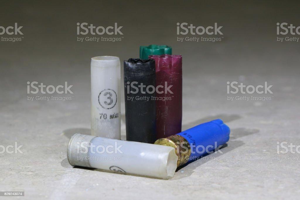 Colorful used shotgun shells on cincrete stock photo