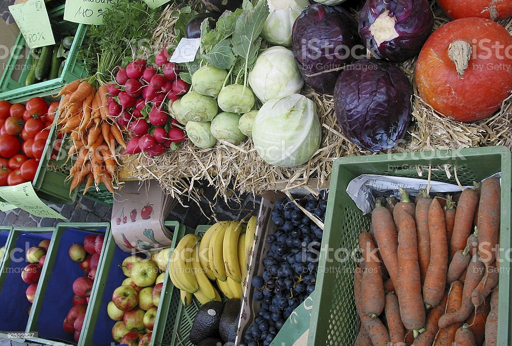 Colorful Variety of vegetables and fruits on street market shelf stock photo