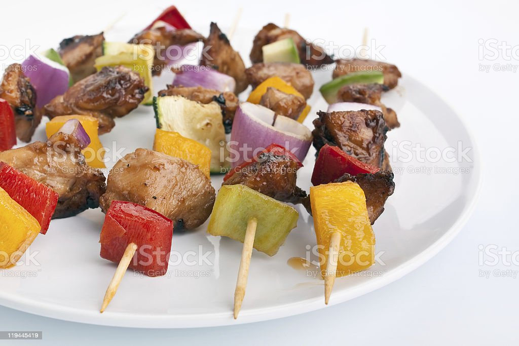 colorful vegetable and meat grilled kebabs stock photo
