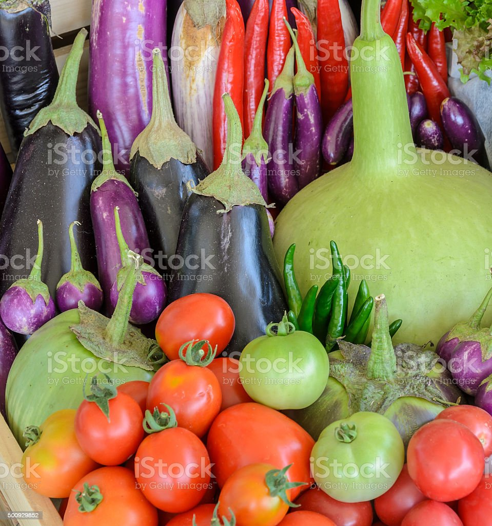 Colorful vegetable in wooden box stock photo