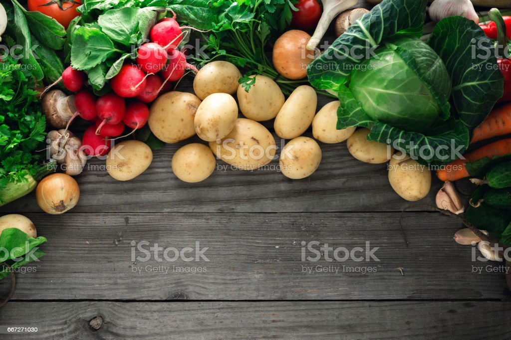 Colorful vegetables background. Set of fresh vegetables on a wooden table with border stock photo