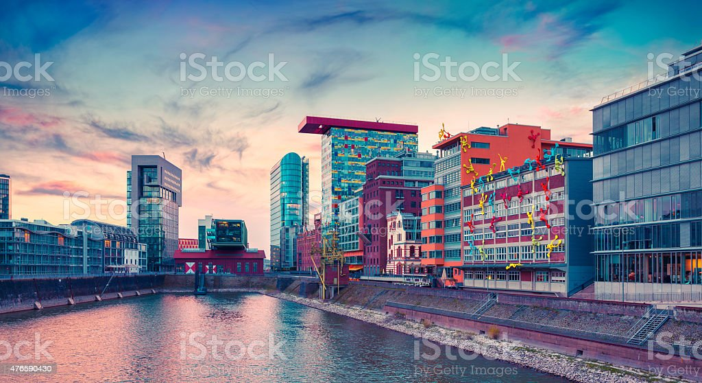 Colorful view of Rhine river at evening in Dusseldorf stock photo