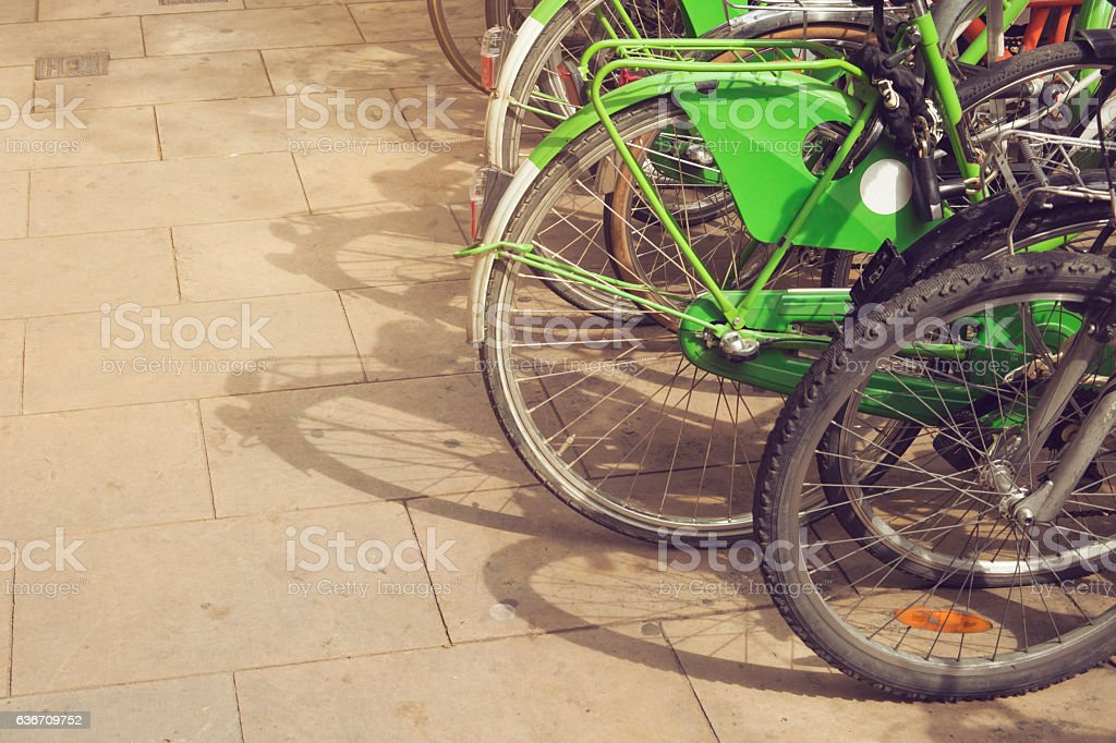 Colorful vintage bicycles parked on a row in Barcelona, Spain stock photo