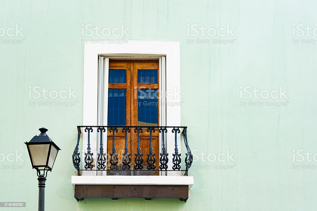 Colorful wall and window with street lamp stock photo