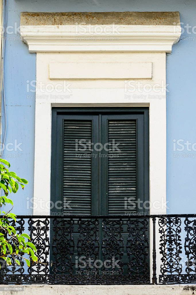 Colorful wall with balcony and door stock photo
