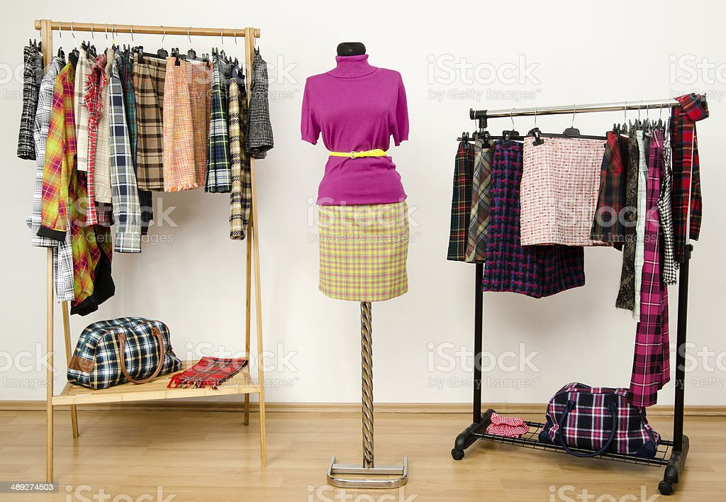 Colorful wardrobe with tartan clothes and accessories. stock photo