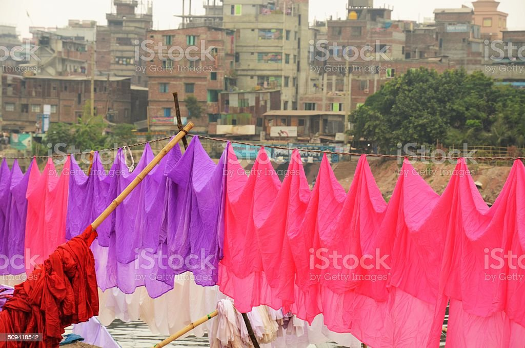 Colorful washing is hanging at the river in Dhaka stock photo