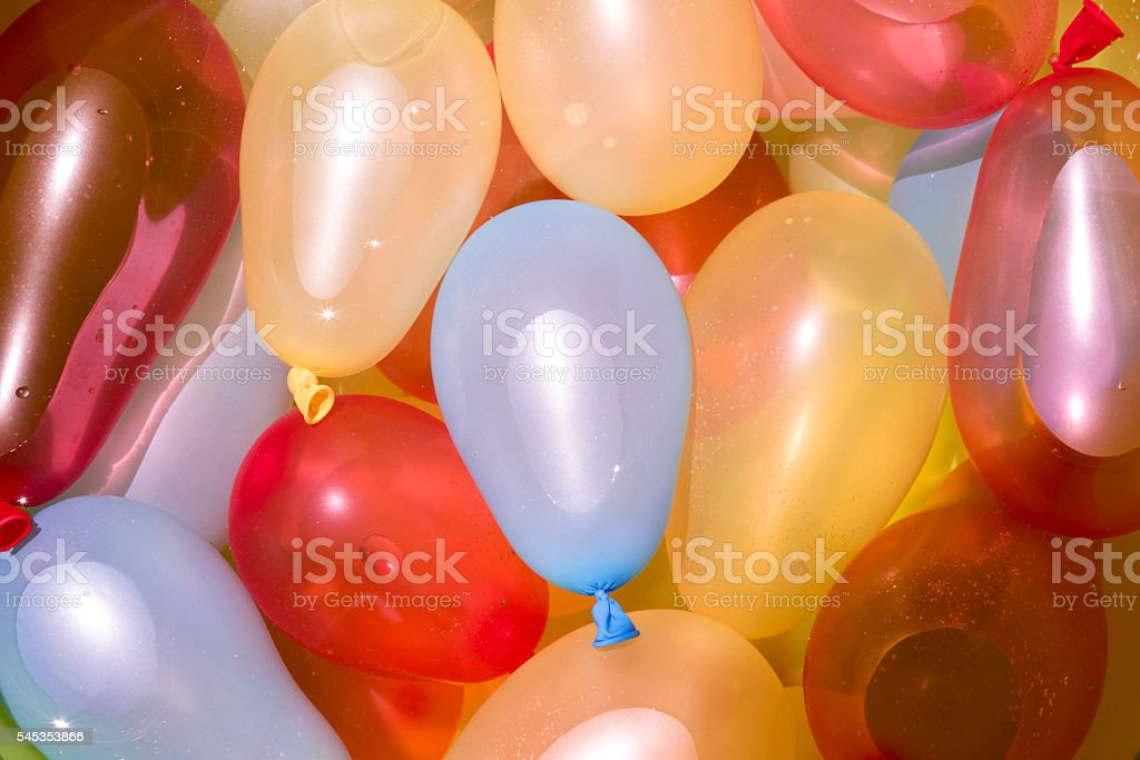 Colorful water balloons background stock photo