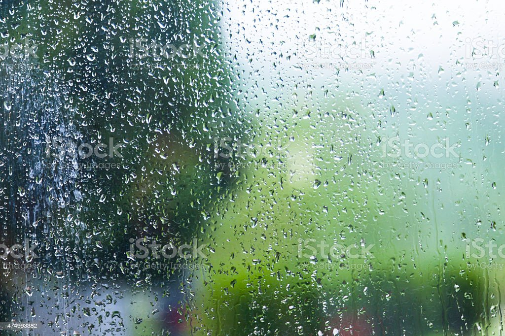 Colorful water drops on a glass stock photo