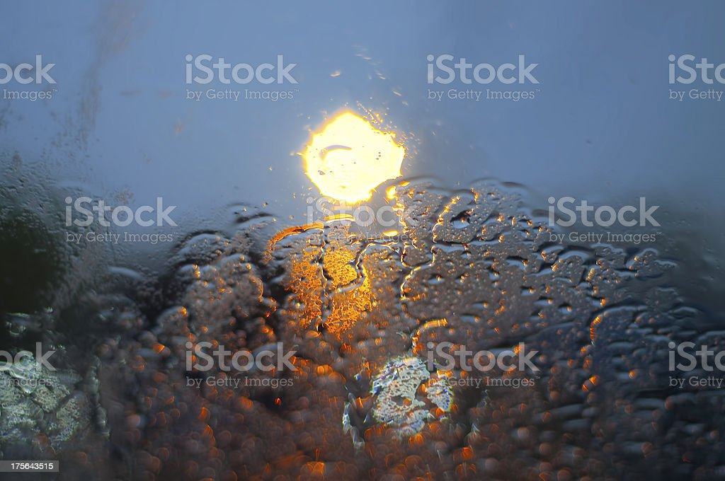 Colorful water drops on window glass stock photo