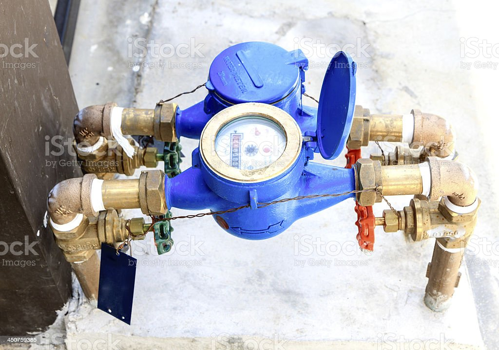 colorful water meter and valve stock photo