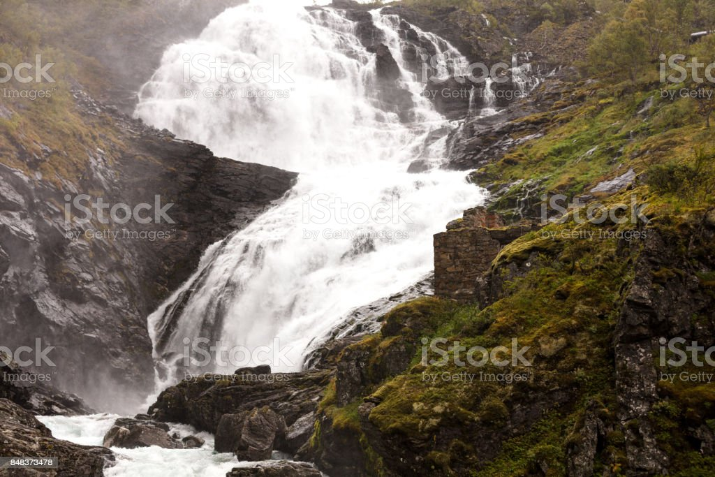 colorful waterfall in norway stock photo