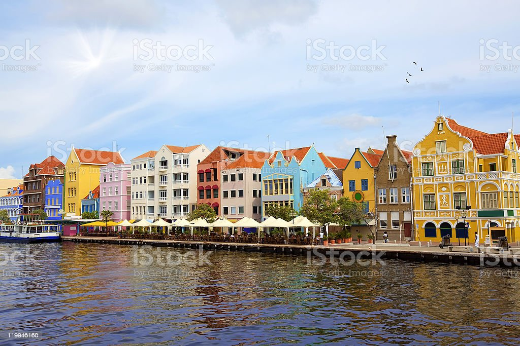 Colorful waterfront houses of Willemstad with reflections stock photo