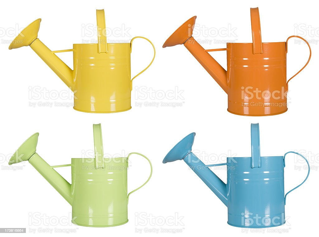 Colorful watering cans royalty-free stock photo