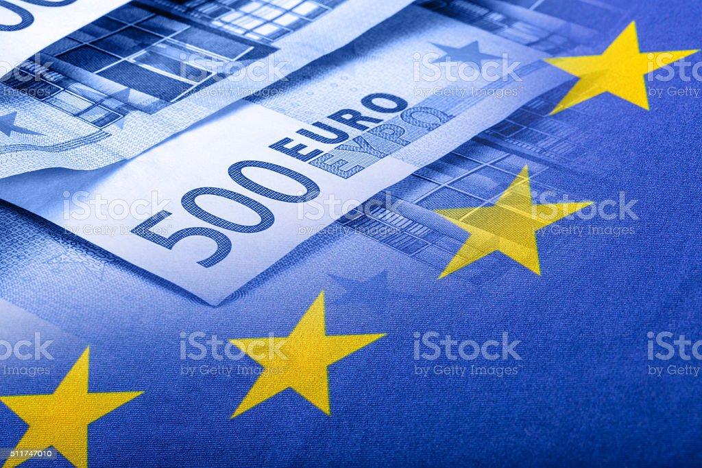 Colorful waving european union flag on a euro money background stock photo