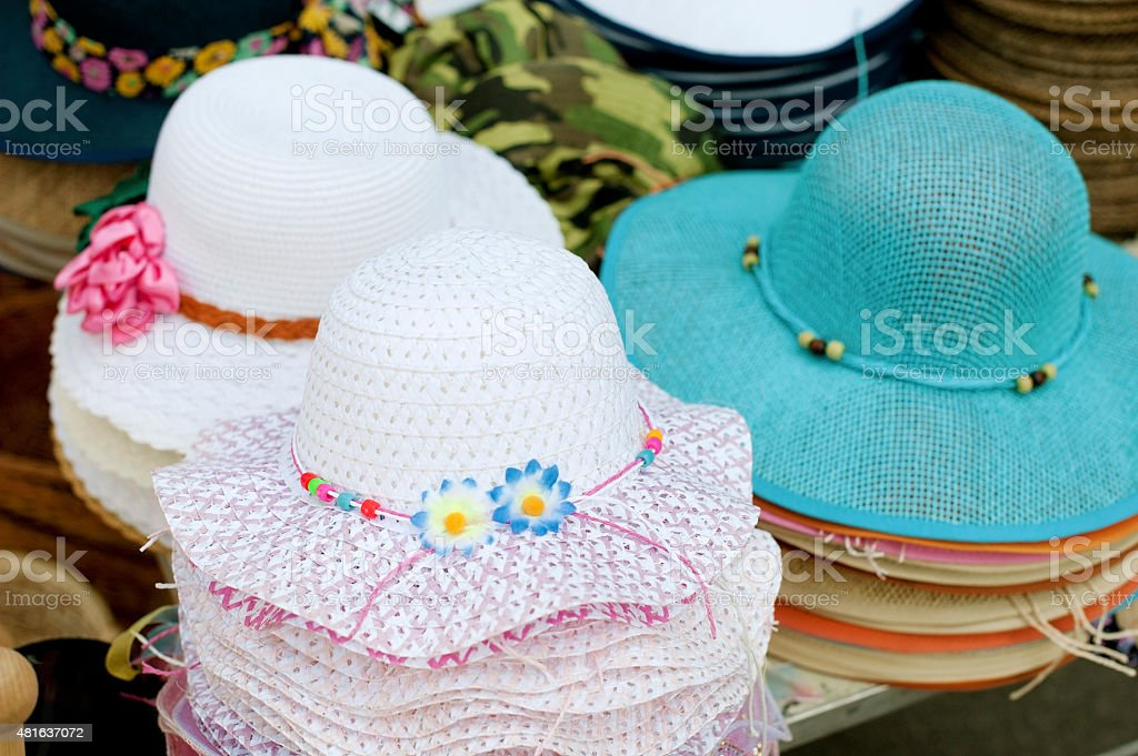 Colorful women`s summer hats for sale at outdoors shop stock photo