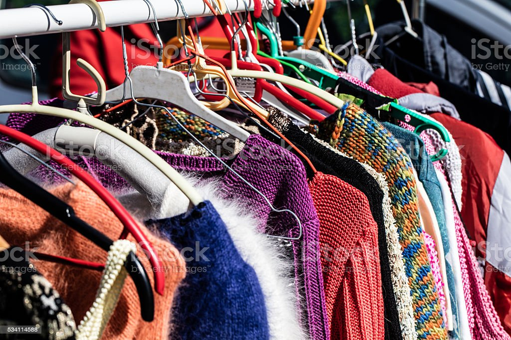 colorful women's sweaters for second life at flea market stock photo