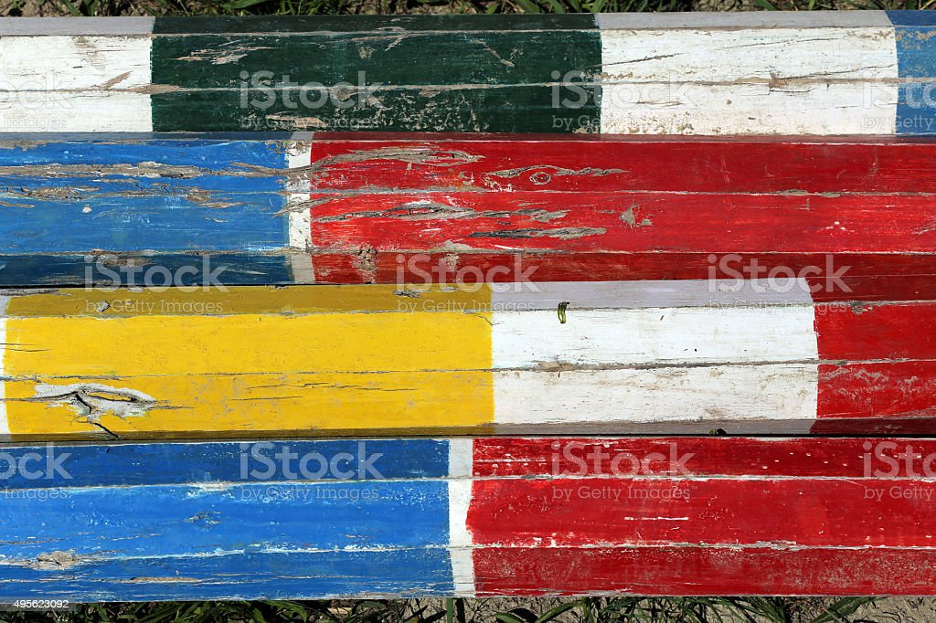 Colorful wooden barriers on the ground for jumping horses stock photo