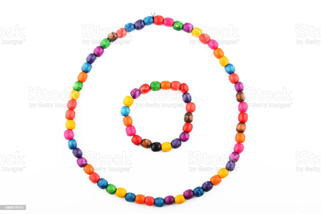 Colorful wooden beads necklace and bracelet isolated on white royalty-free stock photo