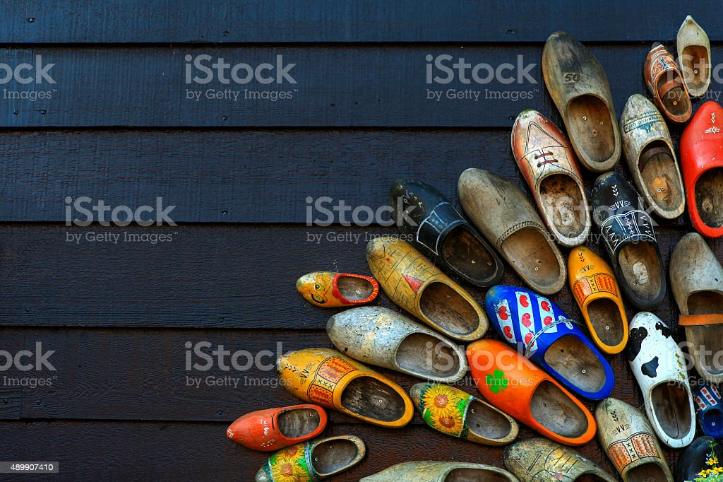 Colorful wooden clogs on dark wooden panels stock photo