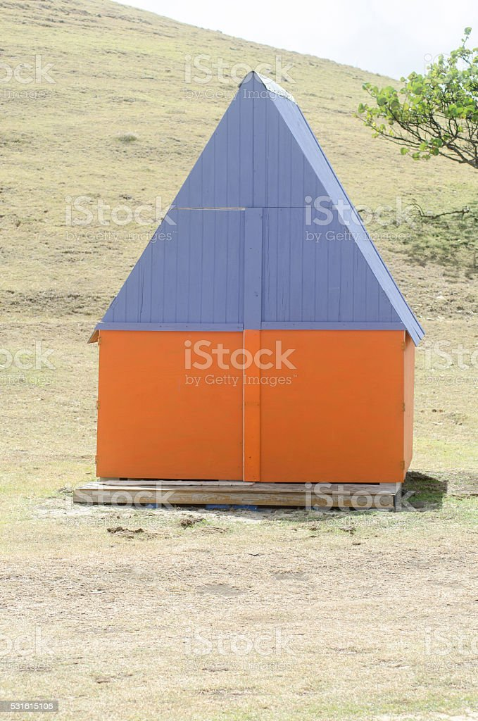 colorful wooden hut in grassy field stock photo