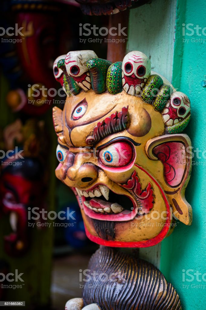 Colorful wooden masks and handicrafts on sale at shop in the Thamel District of Kathmandu, Nepal. stock photo