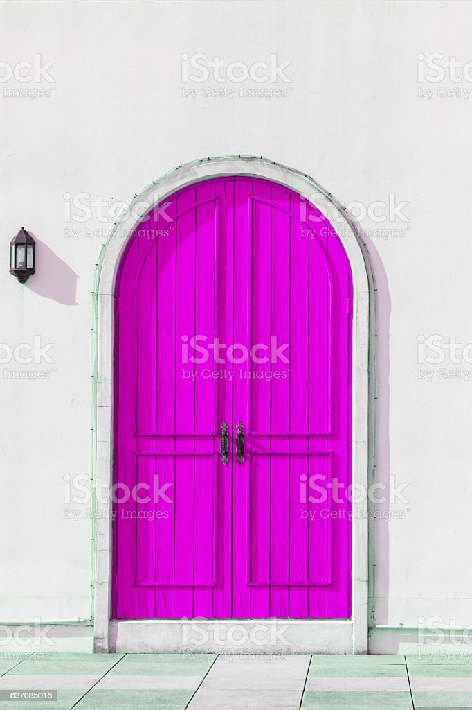 Colorful wooden purple door and Detail of house exterior stock photo