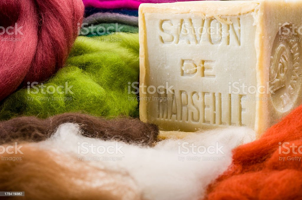 Colorful wool and bar of French soap used for felting  stock photo
