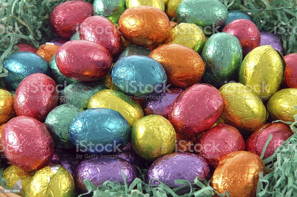 Colorful wrapped Easter eggs in a pile royalty-free stock photo