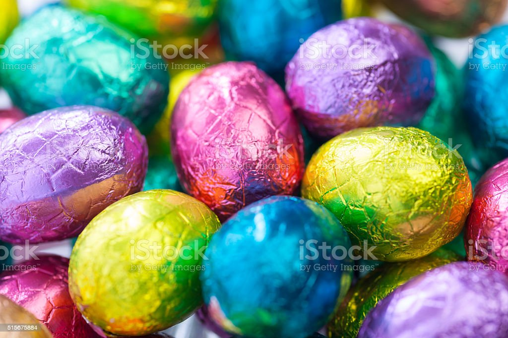 colorful wrapped easter eggs stock photo